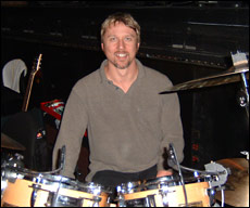 Drummer Ron Briggs in front of his drumset